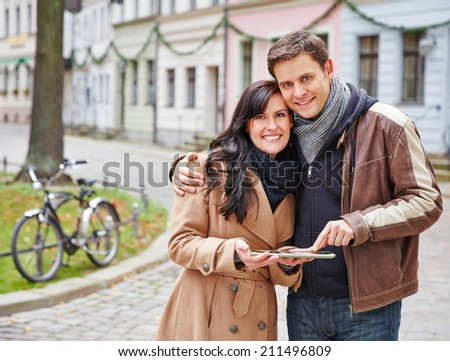 Tourists using tablet PC for navigation in a German city - stock photo