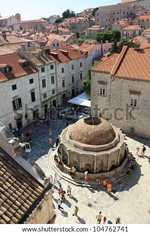 Tourists visiting the water reservoir in Dubrovnik, Croatia. - stock photo