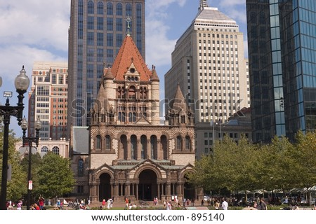 Tourists  visiting Trinity church Boston,  Mass. Made of granite and red sandstone, the low part is based on Romanesque architecture