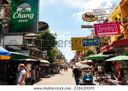Tourists walk along backpacker haven Khao San Road as officials warn visas on arrival may be rolled back in the wake of recent terrorism incidents on Aug 24, 2014 in Bangkok, Thailand. - stock photo