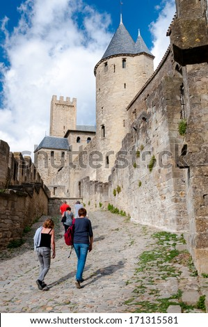 Tourists walkig in the walls of Carcassonne medieval city in France - stock photo