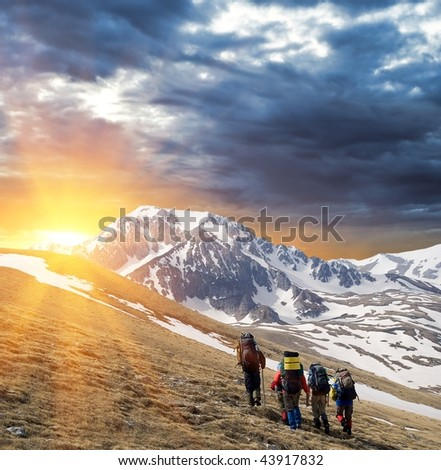 tourists walking to the sun - stock photo