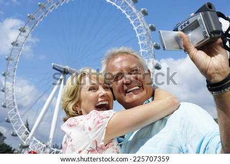 Tourists with Camcorder - stock photo