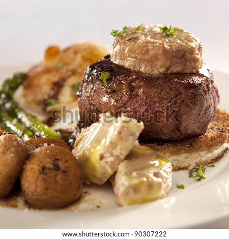 Tournedos Rossini (french steak dish with foie gras and croutons) - stock photo