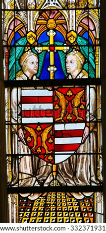 TOURS, FRANCE - AUGUST 14, 2014: Stained glass window depicting a Coats of Arms in the Cathedral of Tours, France. - stock photo