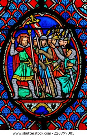 TOURS, FRANCE - AUGUST 14, 2014: Stained glass window depicting Crusaders in the Cathedral of Tours, France. - stock photo