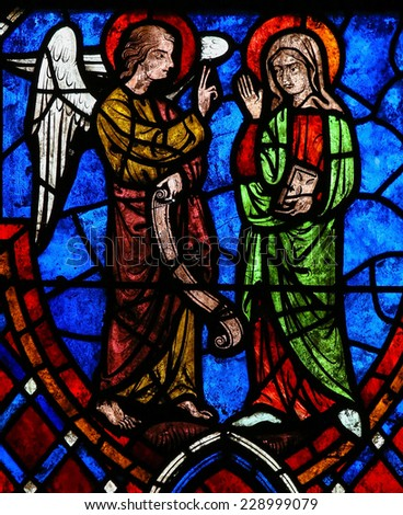 TOURS, FRANCE - AUGUST 14, 2014: Stained glass window depicting the Annunciatio, the visit of Archangel Gabriel to the Blessed Virgin Mary in the Cathedral of Tours, France.