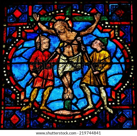TOURS, FRANCE - AUGUST 8, 2014: Stained glass window depicting The Crucifixion of Jesus in the Cathedral of Tours, France. - stock photo