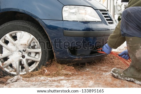 Tow rope being attached to the car towing eyelet - stock photo