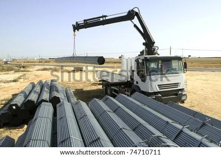 Tow truck, loading iron - stock photo