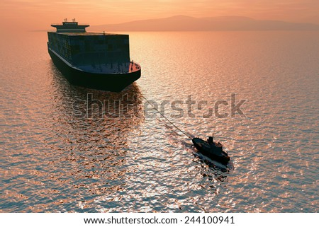 Tow truck pulling a tanker at sea. - stock photo