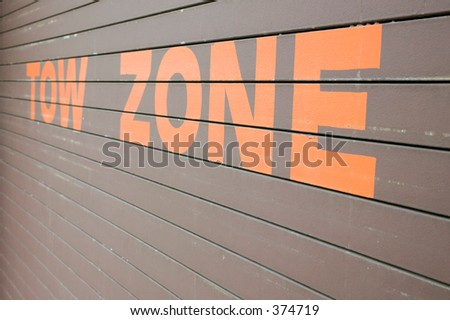 Tow Zone on garage wall - stock photo