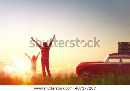 Toward adventure! Happy family relaxing and enjoying road trip. Beautiful young mother and her child girl rejoice in the dawn. - stock photo