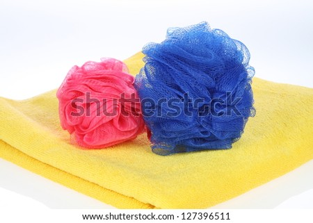 Towel and bath puff - stock photo