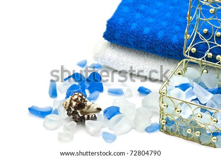 Towel and bath salts. Spa background - stock photo