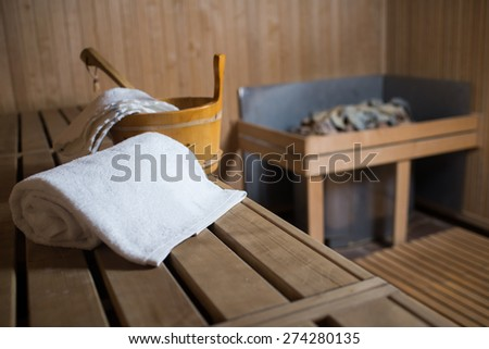 towel and bucket in the sauna on the bench - stock photo