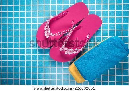 towel and flip flops for the sauna and pool - stock photo