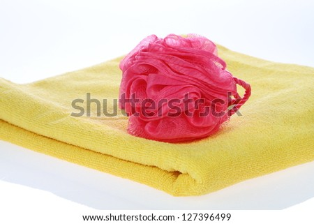 Towel and  red bath puff - stock photo