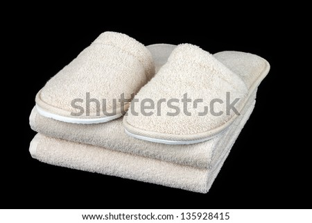 Towel and slipper - stock photo