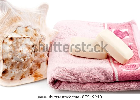 Towel and soap on white background