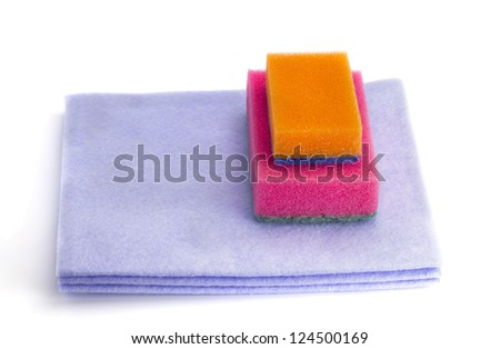 Towel and sponges on the white isolated background - stock photo