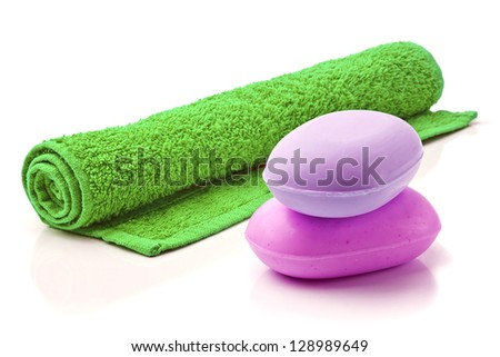 Towel and Stack of new Soap Bars on white background. - stock photo