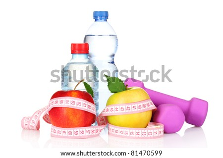 towel, apple with measure tape, dumbbells and water bottle isolated on white