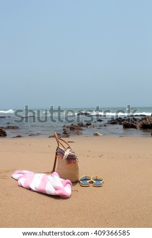 Towel,beach bag and slipper in beach
