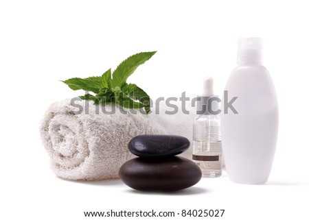 Towel Body Lotions and Black Stones on White Background - stock photo