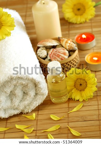 towel, bottle, gerber and candles