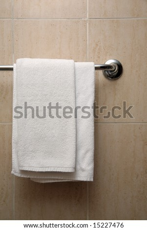 towel hangs on a hanger in a bathroom