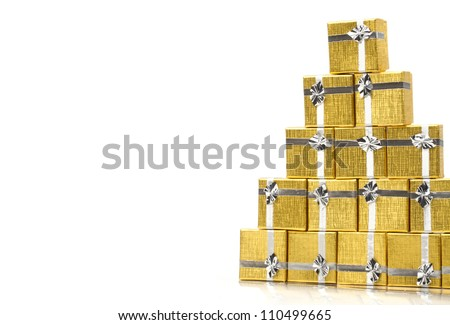 Towel of gold gift boxes on white background - stock photo