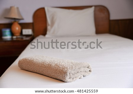 towel on the bed in Resort and Spa