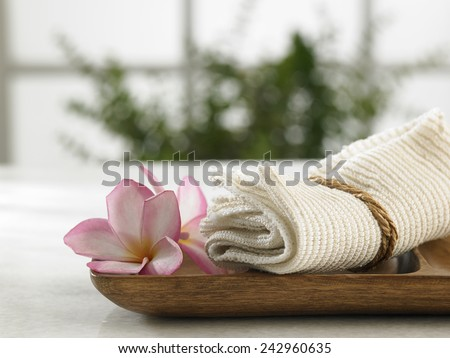 towel on the wooden tray - stock photo