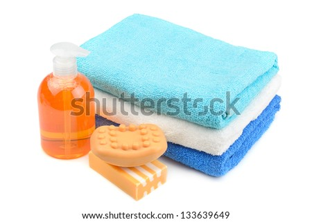 Towel, soap, shampoo isolated on white - stock photo