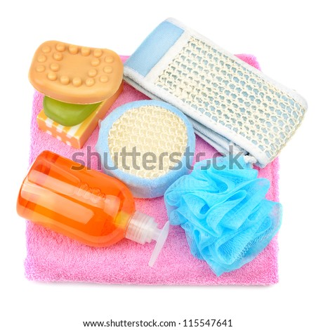 Towel, soap, shampoo, sponge isolated on white - stock photo