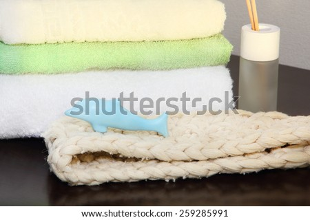 Towel stack and bast in the shower taken closeup. - stock photo