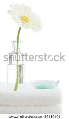 Towel stack with spa objects against a white background. - stock photo