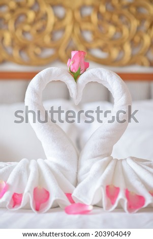 Towel swans on the bed  in hotel