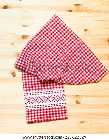 towel white red squares on wooden background   - stock photo