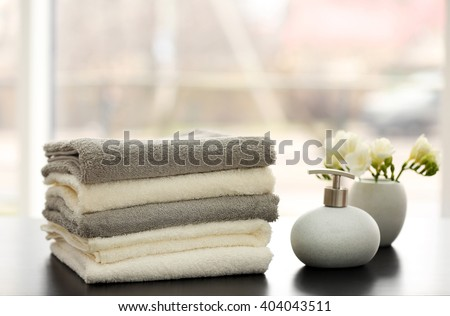 Towels and bath accessories on table - stock photo