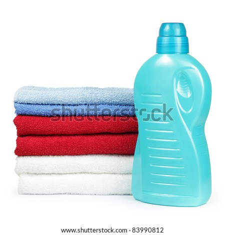 Towels and liquid laundry detergent isolated on white background - stock photo