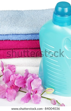 Towels and liquid laundry detergent with orchid flower - stock photo