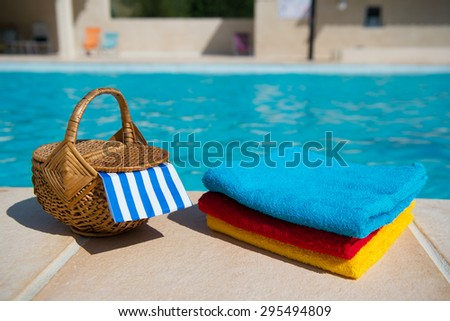 Towels and picnic at te swimming pool - stock photo