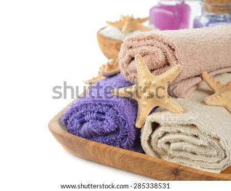 Towels and sea stars on a white background - stock photo