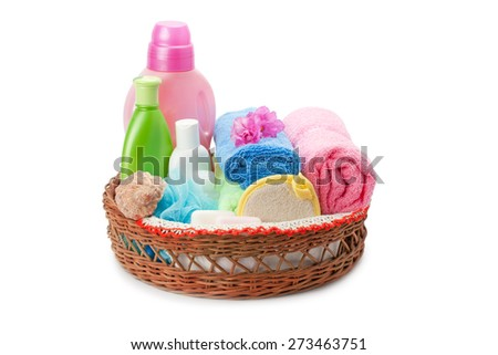 towels and shampoo isolated on white background - stock photo