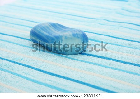 Towels and soap closeup picture. - stock photo