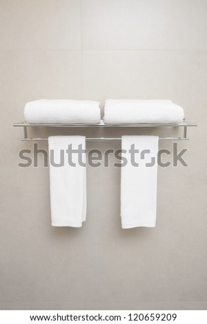 towels for couple prepared on hanger. - stock photo