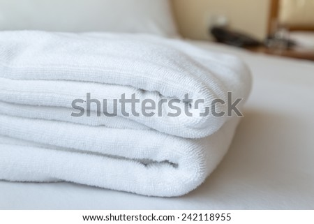 Towels in a hotel room - stock photo