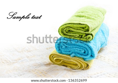 Towels on bed with copyspace and place for your simple text - stock photo